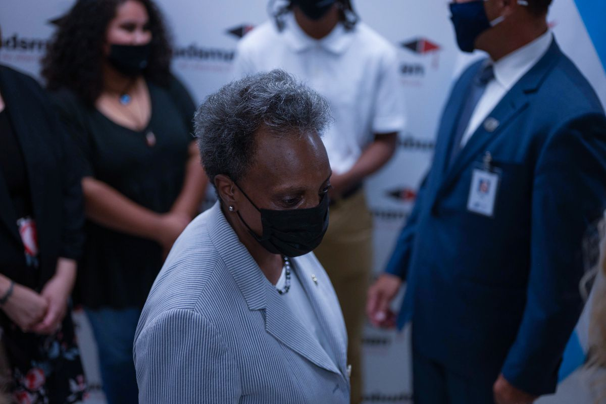 Chicago Mayor Lori Lightfoot wears a mask on the first day of school.