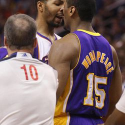 Los Angeles Lakers' Metta World Peace (15) and Phoneix Suns' Markieff Morris exchange words during the first half of an NBA basketball game, Saturday, April 7, 2012, in Phoenix.