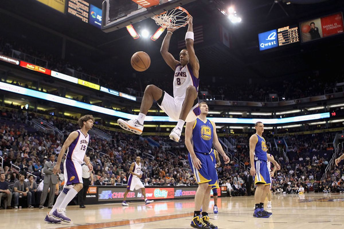 PHOENIX AZ - FEBRUARY 10:  Channing Frye #8 of the Phoenix Suns slam dunks the ball against the Golden State Warriors during the NBA game at US Airways Center on February 10 2011 in Phoenix Arizona.    (Photo by Christian Petersen/Getty Images)