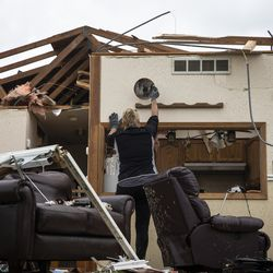 Sandra Baar, 65, of Dixon, helps clear out her sister's house on Janes Avenue near Evergreen Lane in Woodridge after a tornado ripped through the western suburbs overnight, Monday morning, June 21, 2021. | Ashlee Rezin Garcia/Sun-Times