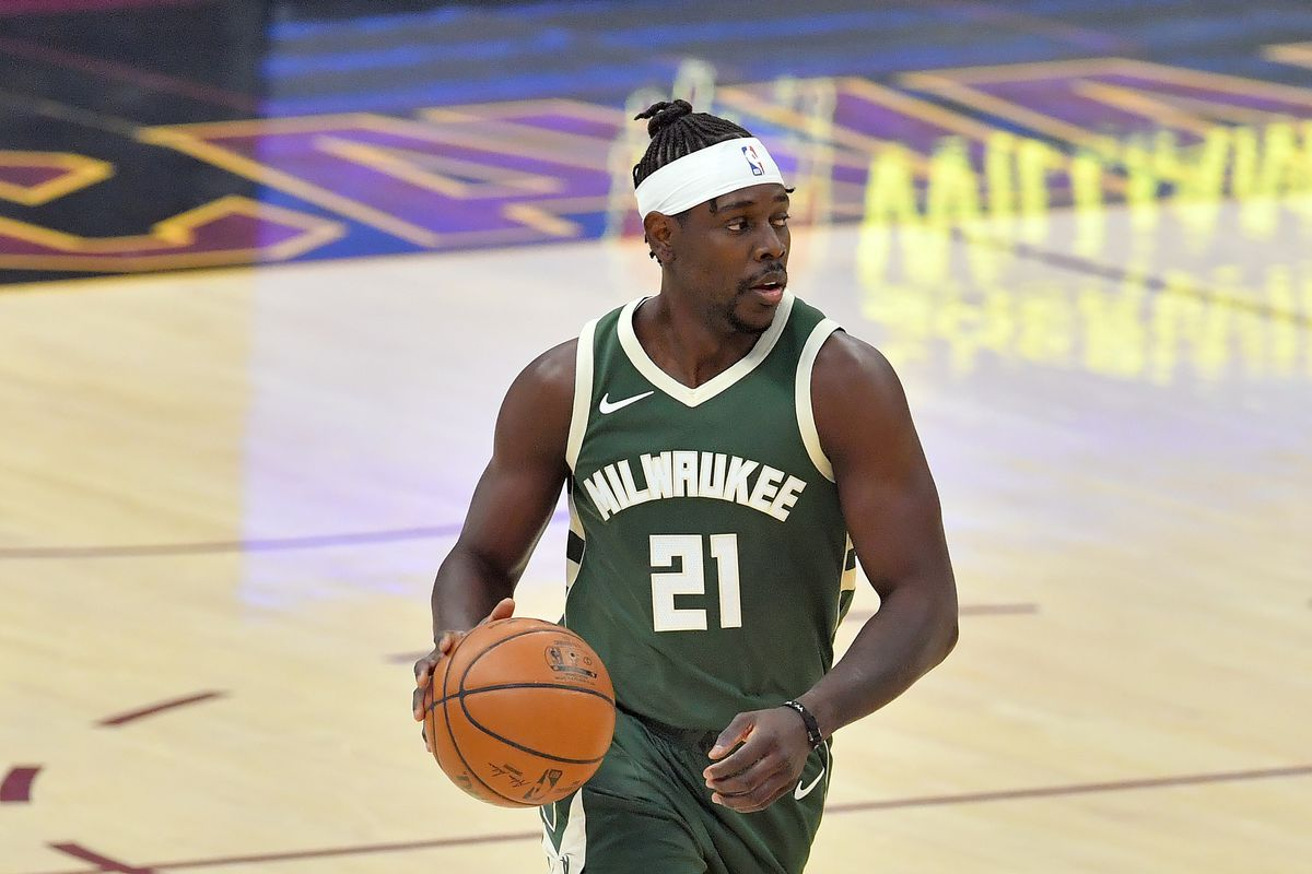 Jrue Holiday of the Milwaukee Bucks brings the ball up court during the first half against the Cleveland Cavaliers at Rocket Mortgage Fieldhouse on February 06, 2021 in Cleveland, Ohio.