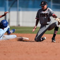 The ball sails past American Fork second baseman Ryder Robinson, allowing Pleasant Grove's Brody Ballantye to make it to third on a steal in a high school baseball game in Pleasant Grove on Tuesday, May 4, 2021.