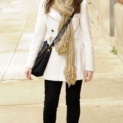 On Mira: denim from Levi's, a top from H&M, a scarf from Anthropologie, a Marc Jacobs bag and Boots from Steve Madden.