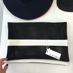 Leather clutch, $65 (was $280)