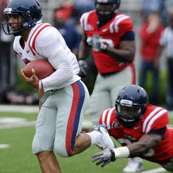 Mississippi quarterback Barry Brunetti (11) is chased by Gerald Rivers during their annual spring NCAA college football game in Oxford, Miss. on Saturday, April 21, 2012.