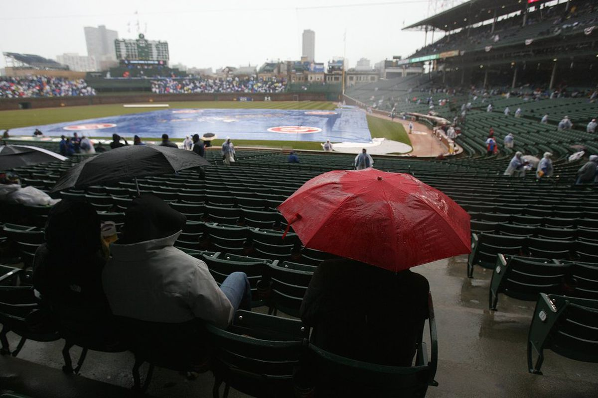 General view as fans sit in the rain at Wrigley Field in Chicago, Illinois. (Photo by Jonathan Daniel/Getty Images)