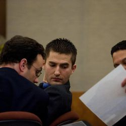 Martin Bond turns to look at a piece of evidence held by prosecutor Tim Taylor on the first day of Bond's trial in 4th District Court in American Fork Wednesday, Jan. 16, 2013. Bond is accused of killing former BYU professor Kay Mortensen in November 2009.
