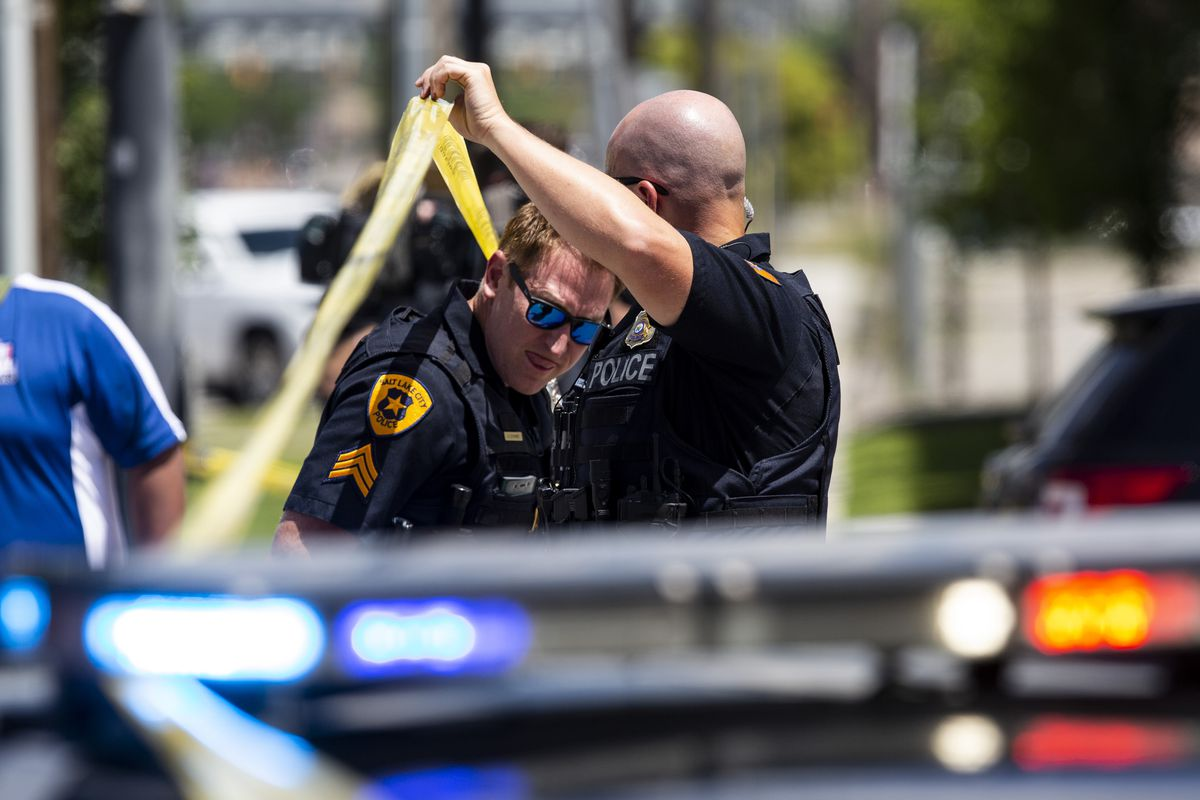 Police man the scene of an officer-involved shooting at the Sunrise Metro Apartment complex, 580 S. 500 West, in Salt Lake City on Monday, July 15, 2019. One person was shot and killed and a police officer was shot and injured.