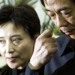 FILE - In this Jan. 17, 2007 file photo, Gu Kailai, left, wife of then Chinese Commerce Minister Bo Xilai, right, attends a memorial ceremony for Bo's father Bo Yibo, a late revolutionary leader considered one of communist China's founding fathers, at a military hospital in Beijing. Hours after Gu Kailai poisoned a British businessman, she reached out to a trusted ally: Wang Lijun. Wang was Bo's chief of police and longtime collaborator. According to an account released Wednesday, Sept. 19, 2012 by the government's Xinhua News Agency, when a panicked Gu turned to Wang for assistance following the murder, Wang helped her cover up the crime.