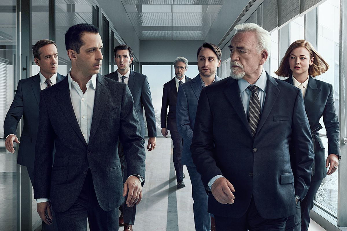 The various members of the Roy family march down the hall, Kendall and Logan glaring at each other.