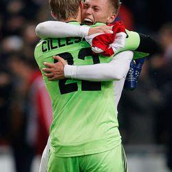 Jasper Cillessen and Viktor Fischer of Ajax soccer club in Amsterdam celebrate.
