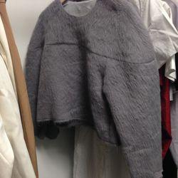 Behno faux fur top, $50
