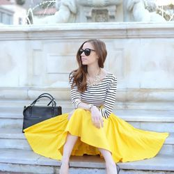 """Mara of <a href=""""http://www.mlovesmblog.com""""target=""""_blank"""">M Loves M</a> is wearing a Nordstrom top, a <a href=""""http://leannebarlow.com/products/3100602-take-a-bow-skirt-sunny""""target=""""_blank""""> Leanne Barlow</a> skirt, <a href=""""http://www.zappos.com/gues"""