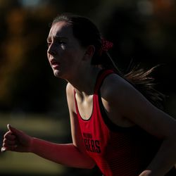 Kinley Spaulding of Milford runs on her way to second place in the 1A girls cross country championship at Sugar House Park in Salt Lake City on Wednesday, Oct. 23, 2019.