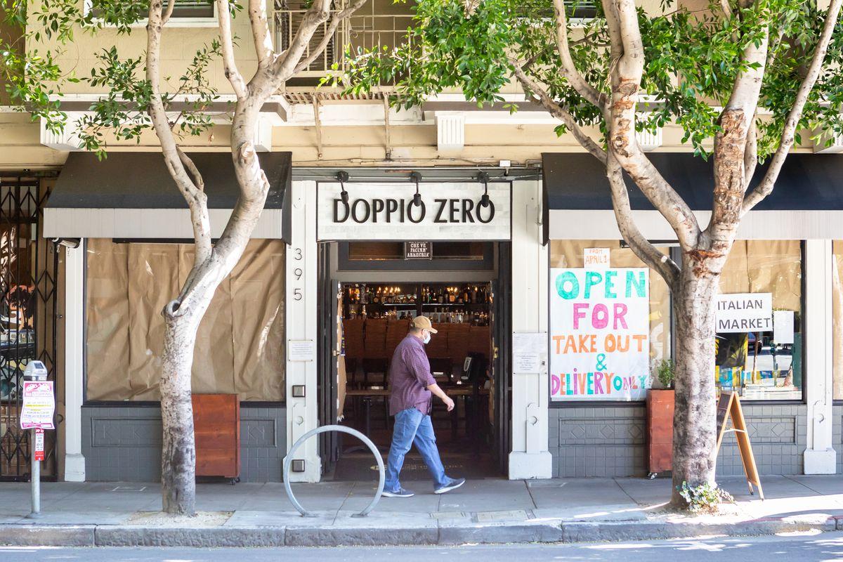 The windows at Doppio Zero are papered over