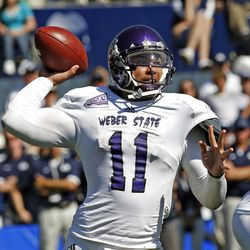 Weber State's Mike Hoke (11) attempts a pass during the Wildcats' 45-13 loss to BYU. Hoke completed 13-of-26 passes for only 91 yards.