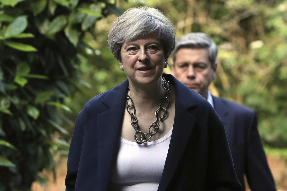 Britain's Prime Minister Theresa May arrives to attend Holy Communion at St Andrew's Church in Sonning, Berkshire, England, Sunday, June 11, 2017. May is under pressure after the Conservatives lost their parliamentary majority in Thursday's election. (Jon
