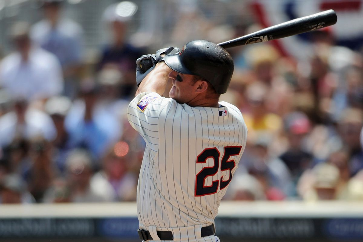 MINNEAPOLIS, MN - JULY 3: Jim Thome #25 of the Minnesota Twins hits a solo home run against the Milwaukee Brewers in the second inning on July 3, 2011 at Target Field in Minneapolis, Minnesota. (Photo by Hannah Foslien/Getty Images)