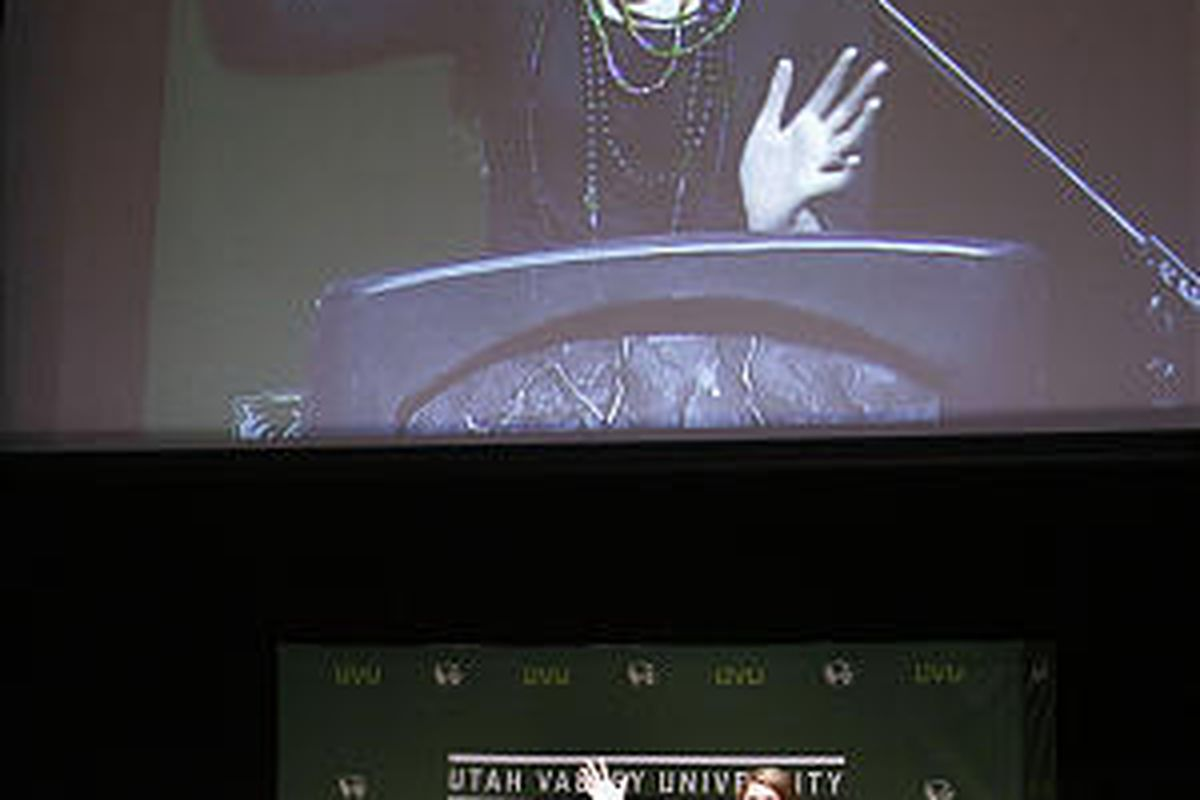 Leigh Anne Tuohy, left, and daughter Collins Tuohy, seen on screen, speak at Utah Valley University on Tuesday.