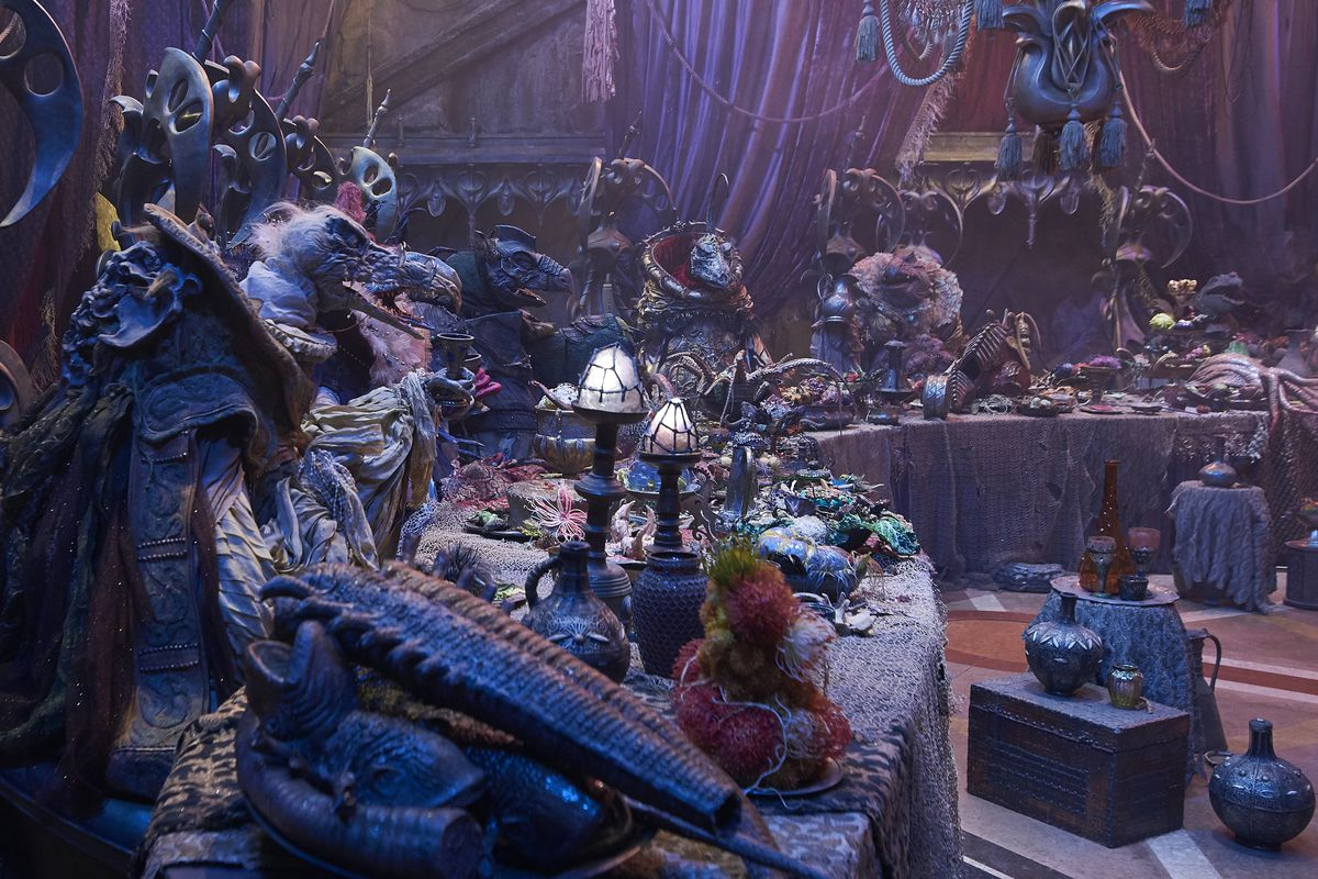 A party scene from the movie The Dark Crystal: Age of Resistance showing the puppet characters sitting at banquet tables.