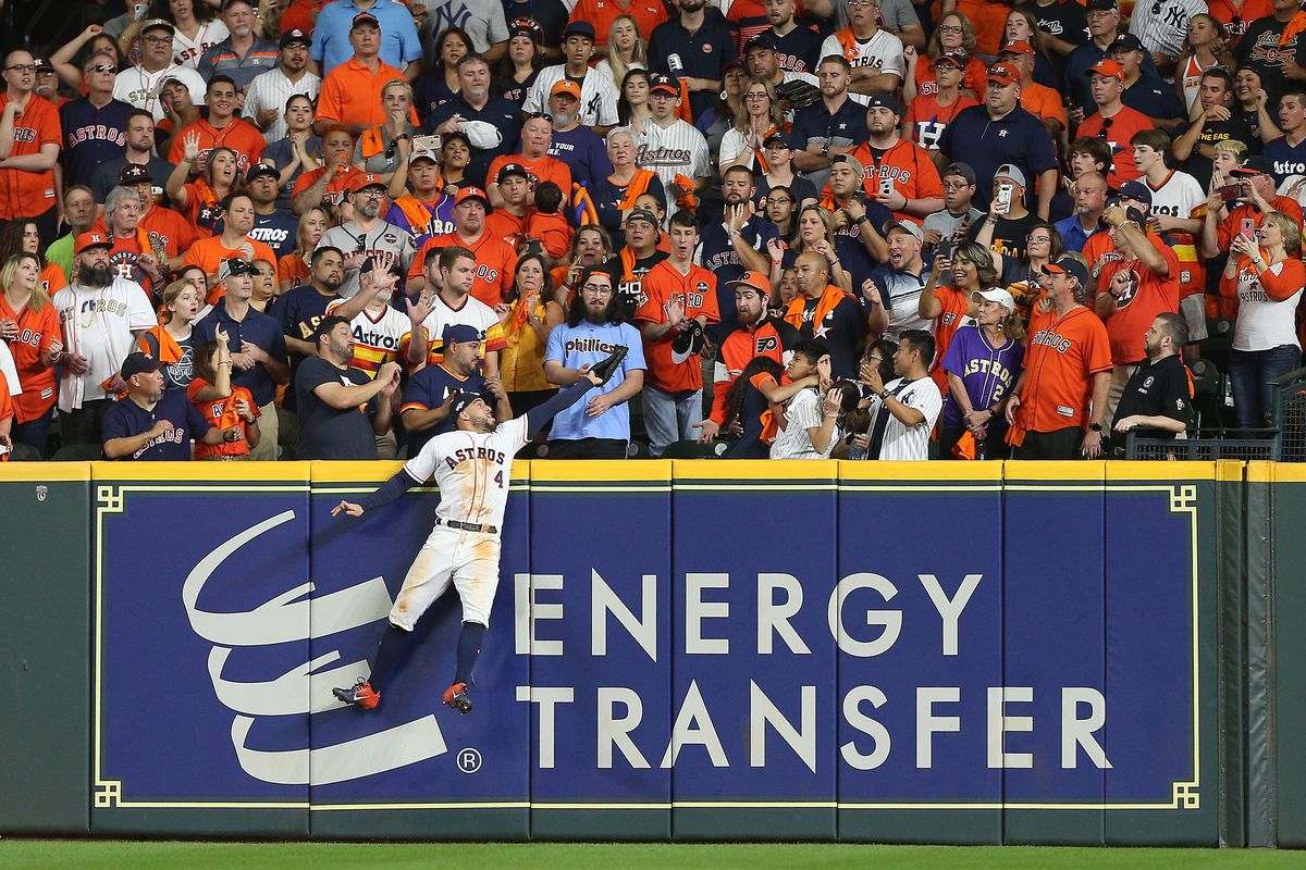 George Springer of the Houston Astros fails to catch a game-tying two-run home run hit by DJ LeMahieu in Game 6 of the ALCS