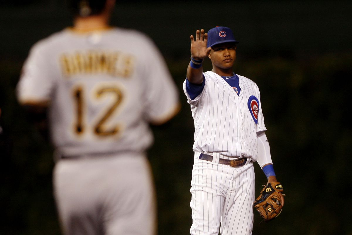 Chicago, IL, USA; Chicago Cubs shortstop Starlin Castro signals to Pittsburgh Pirates shortstop Clint Barmes to stop on a foul ball at Wrigley Field. Credit: Jerry Lai-US PRESSWIRE