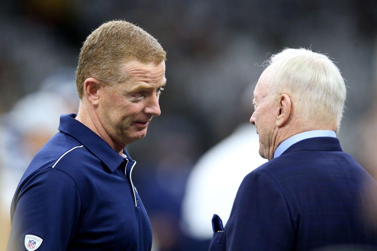 Dallas Cowboys head coach Jason Garrett talks to team owner Jerry Jones before their game against the New Orleans Saints at the Mercedes-Benz Superdome.