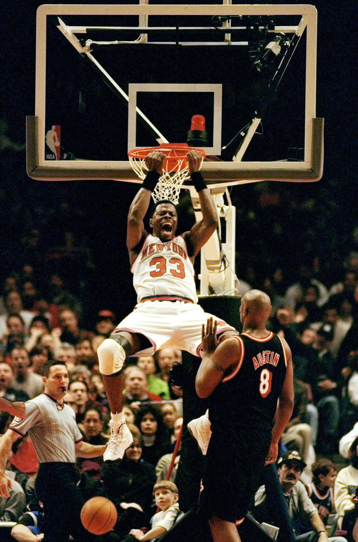 New York Knicks' Patrick Ewing does a reverse slam dunk duri