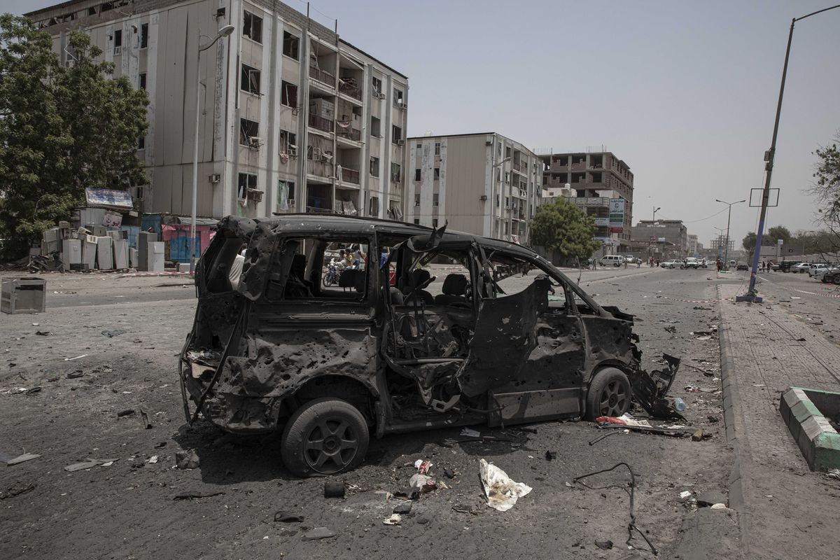 A destroyed vehicle remains at the site of a deadly attack on the Sheikh Othman police station in Aden, Yemen, Thursday, Aug. 1, 2019. Yemen's rebels have fired a ballistic missile at a military parade in the southern port city of Aden as coordinated suic