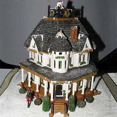 Black gingerbread house roof and white exterior.