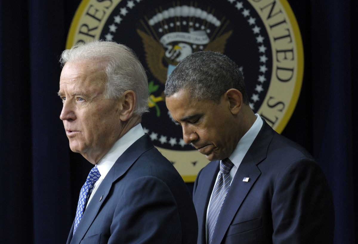 In this Jan. 16, 2013 file photo, President Barack Obama listens as Vice President Joe Biden speaks in the South Court Auditorium at the White House in Washington, about proposals to reduce gun violence. President Barack Obama promised after the Newtown shootings to put his full weight behind gun control, but lasting change did not emerge as divides could not be bridged. AP JAN. 16, 2013..
