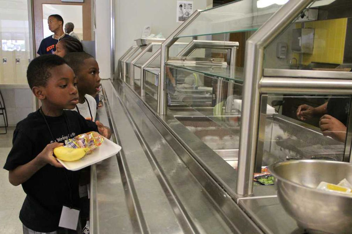 Students lining up for lunch in the cafeteria.