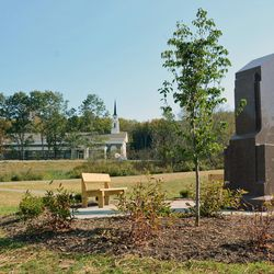 Monument to the Aaronic Priesthood restoration with the newly built chapel/visitors' center at the Priesthood Restoration site.
