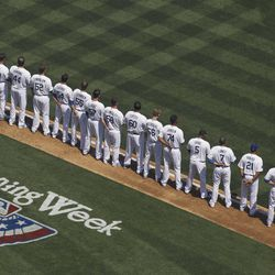 Members of the Los Angeles Dodgers line up before their home-opener baseball game against the Pittsburgh Pirates in Los Angeles, Tuesday, April 10, 2012.