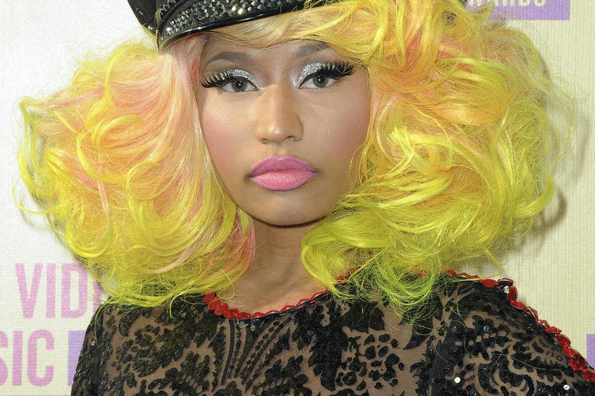 FILE - In this Thurs., Sept. 6, 2012 file photo, Nicki Minaj arrives at the MTV Video Music Awards in Los Angeles. The flamboyant rapper confirmed Monday, Sept. 10, 2012 that she did not endorse Republican nominee Mitt Romney when she rapped about him. He