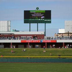 The left-field berm, party deck and scoreboard