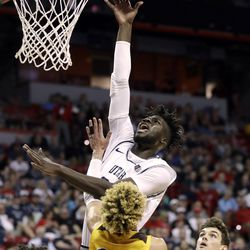 Utah State's Neemias Queta shoots as Wyoming's Hunter Maldonado (24) defends during the first half of an NCAA college basketball game in the Mountain West Conference men's tournament Friday, March 6, 2020, in Las Vegas.