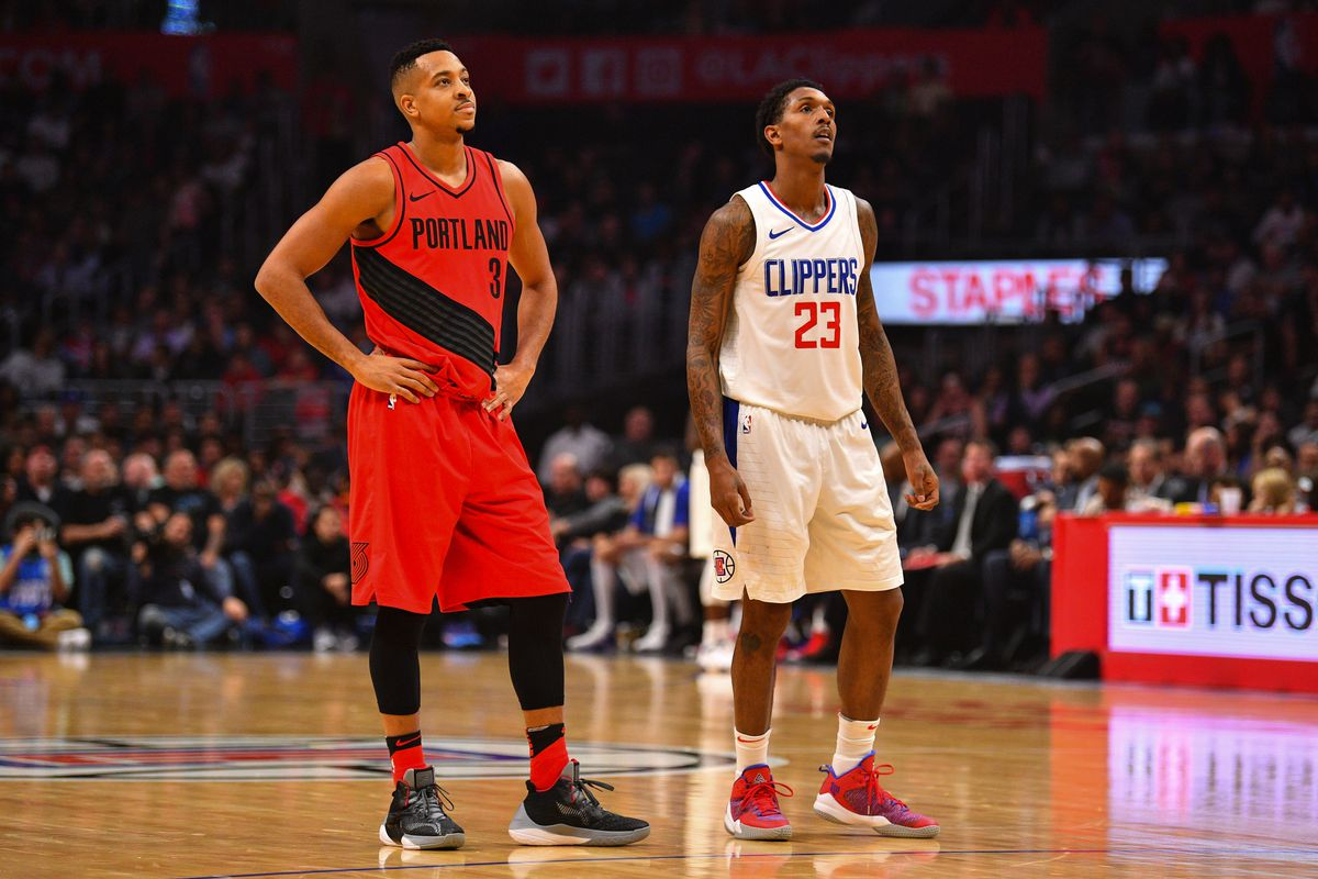 Portland Trail Blazers Guard CJ McCollum and Los Angeles Clippers Guard Lou Williams look on during an NBA game between the Portland Trail Blazers and the Los Angeles Clippers on January 30, 2018 at STAPLES Center in Los Angeles, CA.