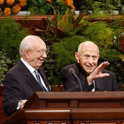 President Gordon B. Hinckley smiles as Elder David B. Haight waves before leaving the Conference Center during October 2003 conference.