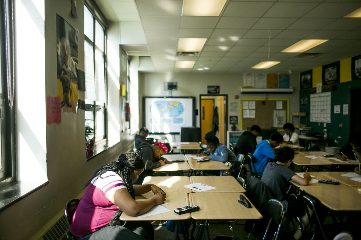 Students at work at tables in a math class at Detroit's Southeastern High School,