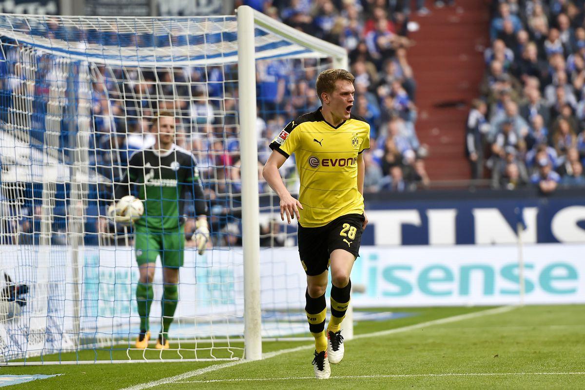 Ginter celebrates his goal against Schalke