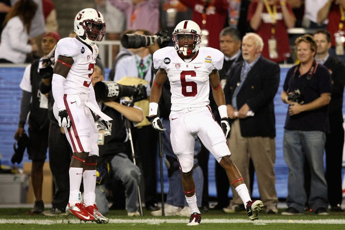 Michael Thomas, left, during a Stanford bowl game