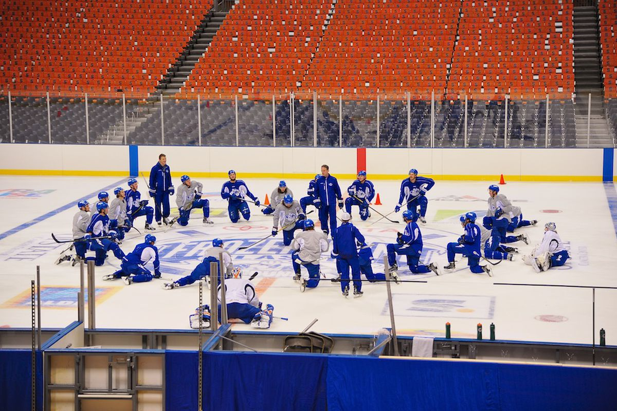 Members of the Syracuse Crunch take in the Carrier Dome from the comfort of home ice durng a light practice this past Thursday