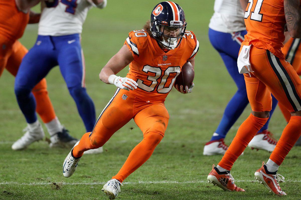 Buffalo Bills v Denver BroncosPhillip Lindsay #30 of the Denver Broncos rushes the ball during the fourth quarter against the Buffalo Bills at Empower Field At Mile High on December 19, 2020 in Denver, Colorado.