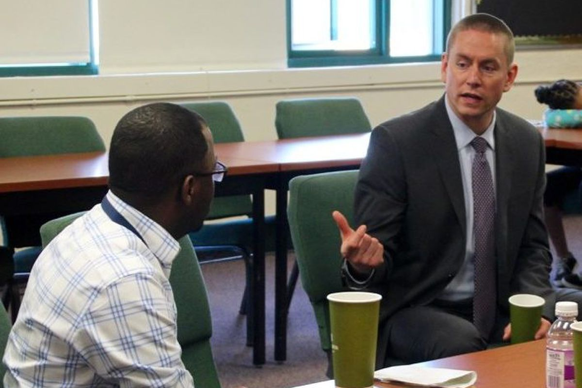 Stephen Osborn (right), a finalist for superintendent of Tennessee's Achievement Schools District, speaks with Mendell Grinter, leader of the Campaign for School Equity, during a meeting at Martin Luther King College Preparatory School in Memphis.