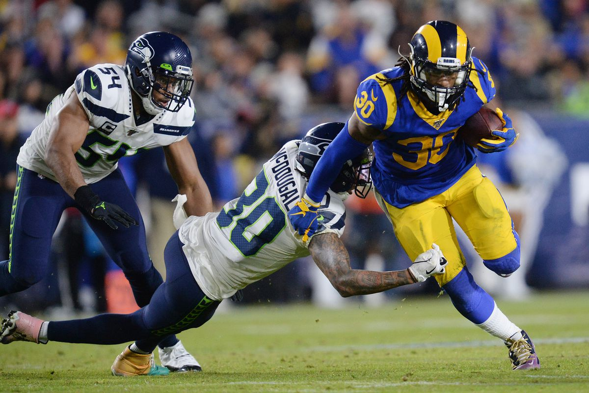 Los Angeles Rams running back Todd Gurley runs the ball against Seattle Seahawks strong safety Bradley McDougald and middle linebacker Bobby Wagner during the second half at the Los Angeles Memorial Coliseum
