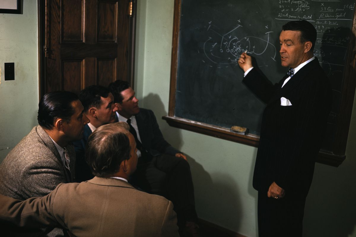 Coach Frank Leahy Instructing Football Players