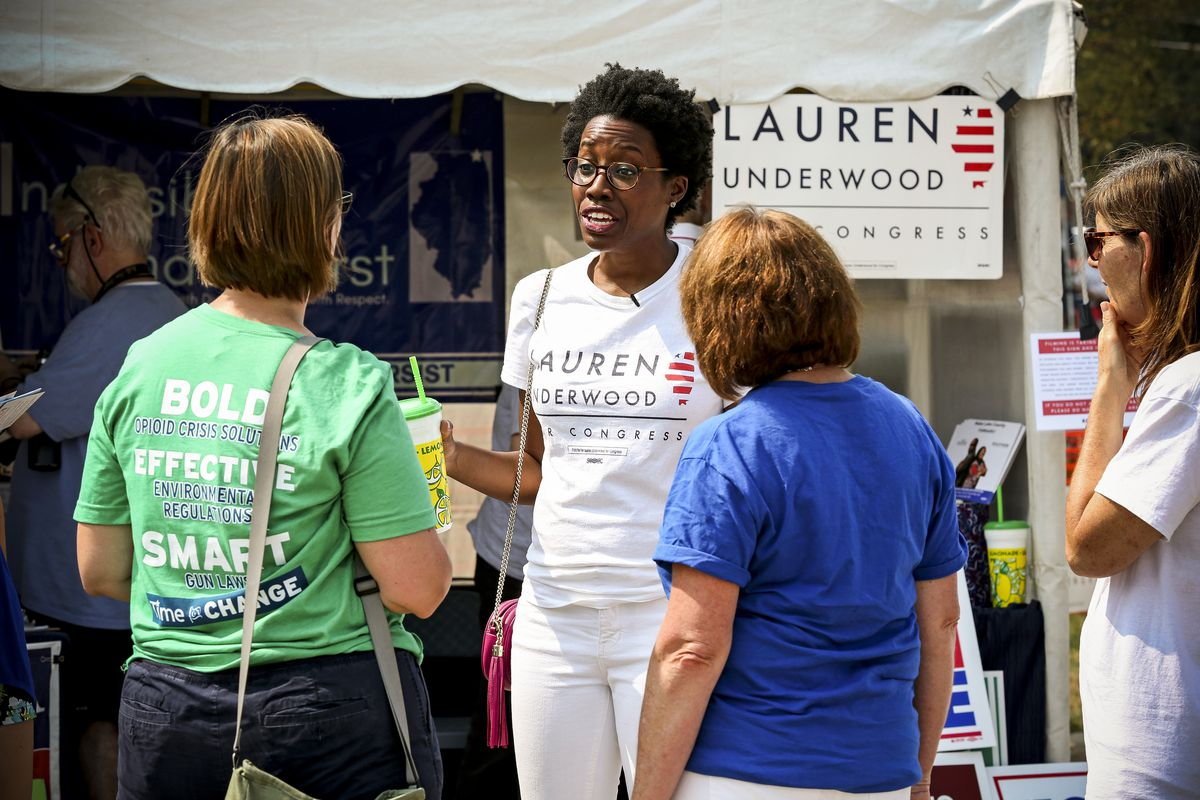 Democratic candidate Lauren Underwood talks with supporters in Lindenhurst, Ill., on August 12, 2018.