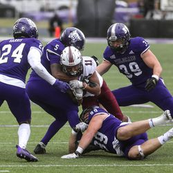 The Weber State Wildcats fight for the ball against a Southern Illinois Saluki at Stewart Stadium in Ogden on Saturday, April 24, 2021.
