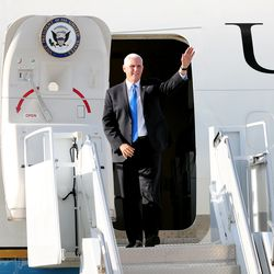 Vice President Mike Pence emerges from Air Force Two and waves to the crowd at the general aviation facilities at Salt Lake City International Airport on Wednesday, Aug. 21, 2019.